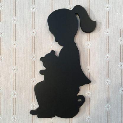 wc kyltti istuva tyttö musta